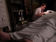 Dustin Sturgill as Victor Frankenstein works on body